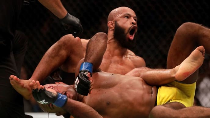 KANSAS CITY, MO - APRIL 15:  Demetrious Johnson celebrates as he defeats Wilson Reis to win their Flyweight Championship bout on UFC Fight Night at the Sprint Center on April 15, 2017 in Kansas City, Missouri.  (Photo by Jamie Squire/Getty Images)
