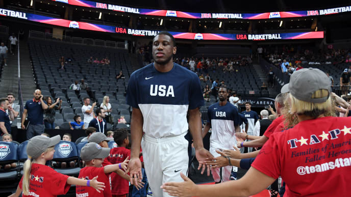 LAS VEGAS, NEVADA - AUGUST 09:  Thaddeus Young #55 of the 2019 USA Men's National Team is greeted by people being assisted by the Tragedy Assistance Program for Survivors (TAPS) before the 2019 USA Basketball Men's National Team Blue-White exhibition game at T-Mobile Arena on August 9, 2019 in Las Vegas, Nevada.  (Photo by Ethan Miller/Getty Images)