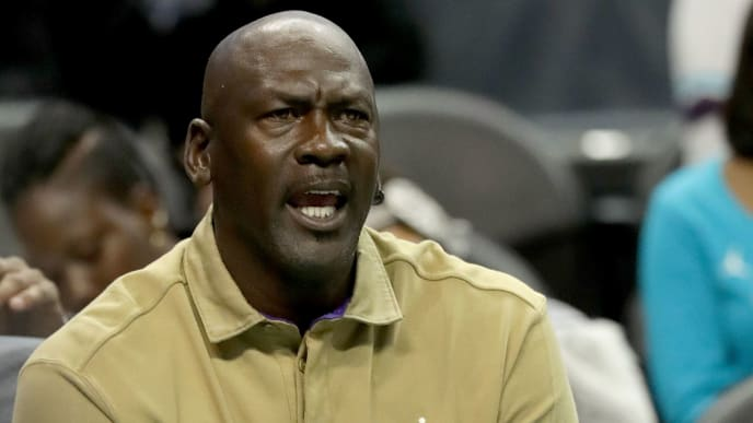 CHARLOTTE, NC - JANUARY 12:  Michael Jordan, owner of the Charlotte Hornets, reacts on the bench during their game against the Utah Jazz at Spectrum Center on January 12, 2018 in Charlotte, North Carolina.  NOTE TO USER: User expressly acknowledges and agrees that, by downloading and or using this photograph, User is consenting to the terms and conditions of the Getty Images License Agreement.  (Photo by Streeter Lecka/Getty Images)
