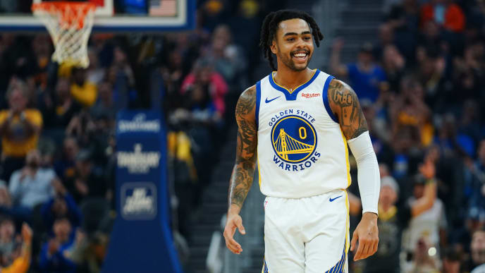 SAN FRANCISCO, CALIFORNIA - NOVEMBER 11: D'Angelo Russell #0 of the Golden State Warriors reacts to a play during the first half against the Utah Jazz at Chase Center on November 11, 2019 in San Francisco, California. NOTE TO USER: User expressly acknowledges and agrees that, by downloading and/or using this photograph, user is consenting to the terms and conditions of the Getty Images License Agreement. (Photo by Daniel Shirey/Getty Images)