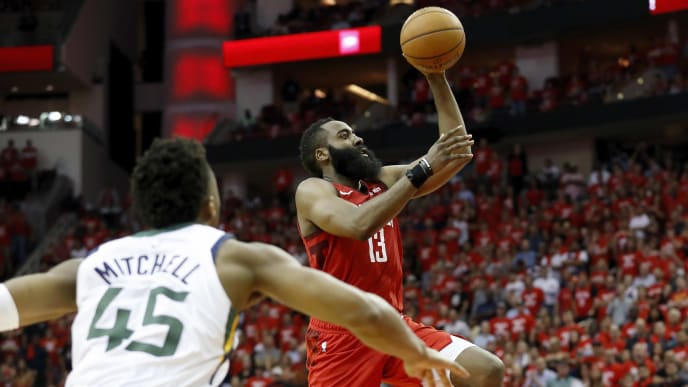 HOUSTON, TX - APRIL 24:  James Harden #13 of the Houston Rockets goes up for a shot defended by Donovan Mitchell #45 of the Utah Jazz in the fourth quarter during Game Five of the first round of the 2019 NBA Western Conference Playoffs between the Houston Rockets and the Utah Jazz at Toyota Center on April 24, 2019 in Houston, Texas.  NOTE TO USER: User expressly acknowledges and agrees that, by downloading and or using this photograph, User is consenting to the terms and conditions of the Getty Images License Agreement.  (Photo by Tim Warner/Getty Images)