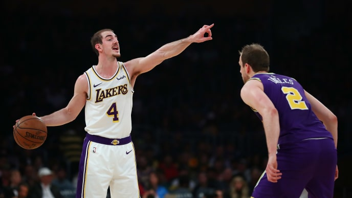 LOS ANGELES, CALIFORNIA - APRIL 07: Alex Caruso #4 of the Los Angeles Lakers directs teammates while controlling the ball against Joe Ingles #2 of the Utah Jazz during the first half at Staples Center on April 07, 2019 in Los Angeles, California. NOTE TO USER: User expressly acknowledges and agrees that, by downloading and or using this photograph, User is consenting to the terms and conditions of the Getty Images License Agreement. (Photo by Yong Teck Lim/Getty Images)