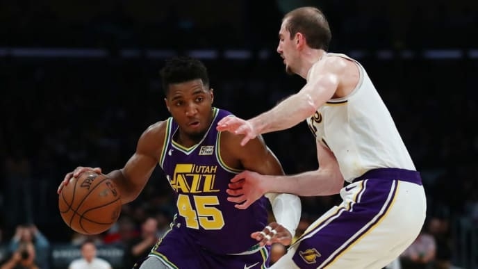 LOS ANGELES, CALIFORNIA - APRIL 07: Donovan Mitchell #45 of the Utah Jazz drives against Alex Caruso #4 of the Los Angeles Lakers during the second half at Staples Center on April 07, 2019 in Los Angeles, California. NOTE TO USER: User expressly acknowledges and agrees that, by downloading and or using this photograph, User is consenting to the terms and conditions of the Getty Images License Agreement. (Photo by Yong Teck Lim/Getty Images)