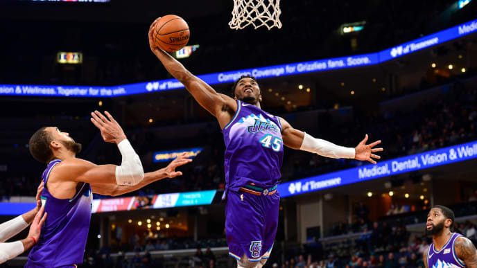 Donovan Mitchell rises up for a rebound against the Memphis Grizzlies.