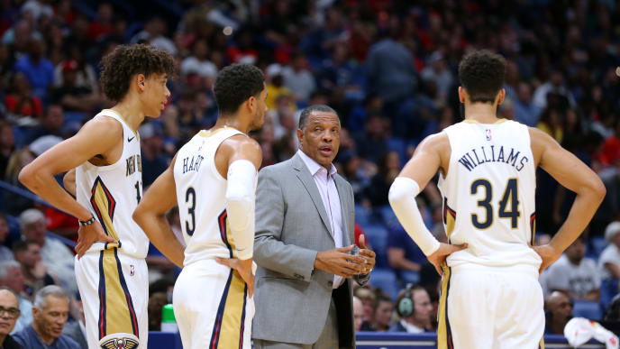 NEW ORLEANS, LOUISIANA - OCTOBER 11: Head coach Alvin Gentry of the New Orleans Pelicans talks with Josh Hart #3, Kenrich Williams #34 and Jaxson Hayes #10 during a preseason game against the Utah Jazz at the Smoothie King Center on October 11, 2019 in New Orleans, Louisiana. NOTE TO USER: User expressly acknowledges and agrees that, by downloading and or using this Photograph, user is consenting to the terms and conditions of the Getty Images License Agreement.  (Photo by Jonathan Bachman/Getty Images)
