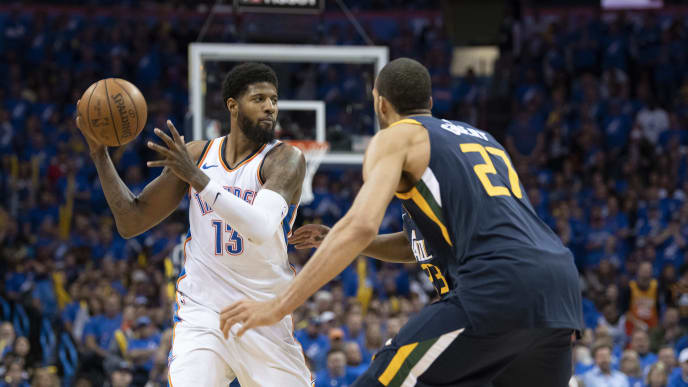 OKLAHOMA CITY, OK - APRIL 15: Paul George #13 of the Oklahoma City Thunder looks to shoot against Rudy Gobert #27 of the Utah Jazz during the second half of Game 1 of the NBA Western Conference playoffs at the Chesapeake Energy Arena on April 15, 2018 in Oklahoma City, Oklahoma. NOTE TO USER: User expressly acknowledges and agrees that, by downloading and or using this photograph, User is consenting to the terms and conditions of the Getty Images License Agreement. (Photo by J Pat Carter/Getty Images)