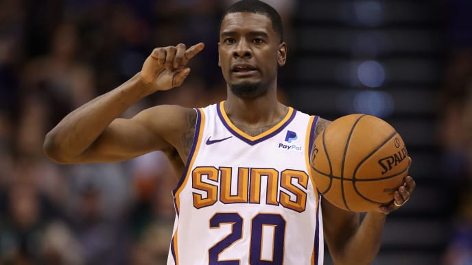 PHOENIX, ARIZONA - APRIL 03:  Josh Jackson #20 of the Phoenix Suns handles the ball during the first half of the NBA game against the Utah Jazz at Talking Stick Resort Arena on April 03, 2019 in Phoenix, Arizona. (Photo by Christian Petersen/Getty Images)