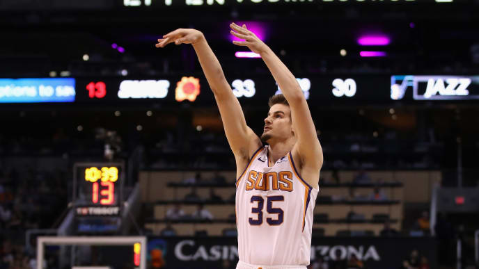 PHOENIX, ARIZONA - APRIL 03:  Dragan Bender #35 of the Phoenix Suns attempts a three-point shot against the Utah Jazz during the first half of the NBA game at Talking Stick Resort Arena on April 03, 2019 in Phoenix, Arizona. (Photo by Christian Petersen/Getty Images)