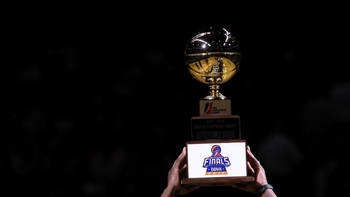 SAN ANTONIO, TX - MAY 02:  The Austin Toros hold the NBA Developmental League Championship trophy at AT&T Center on May 2, 2012 in San Antonio, Texas.  NOTE TO USER: User expressly acknowledges and agrees that, by downloading and or using this photograph, User is consenting to the terms and conditions of the Getty Images License Agreement.  (Photo by Ronald Martinez/Getty Images)
