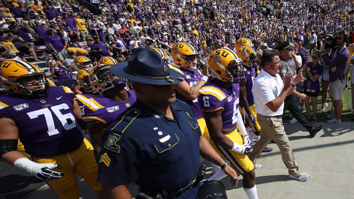 BATON ROUGE, LOUISIANA - OCTOBER 05: Head coach Ed Ogeron of the LSU Tigers leads his team onto the field prior to  the game against the Utah State Aggies at Tiger Stadium on October 05, 2019 in Baton Rouge, Louisiana. (Photo by Chris Graythen/Getty Images)