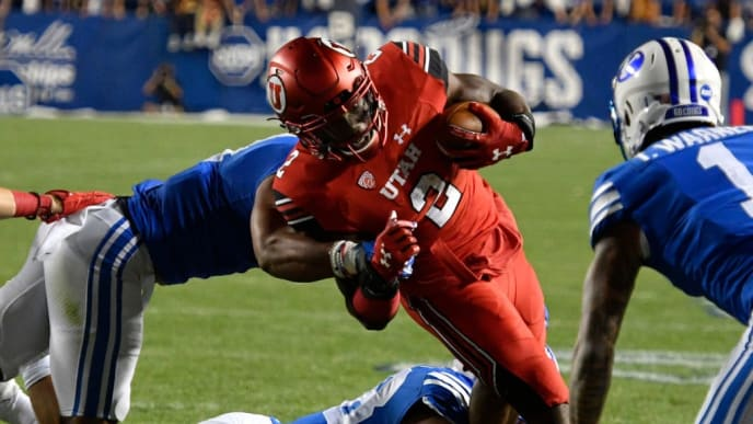 PROVO, UT - SEPTEMBER 9: Zack Moss #2 of the Utah Utes is brought down short of the goal line in the first half against the Brigham Young Cougars at LaVell Edwards Stadium on September 9, 2017 in Provo, Utah. (Photo by Gene Sweeney Jr/Getty Images)