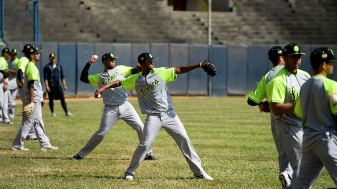 Players of the Venezuelan baseball team Leones del Caracas attend a training session at the Universitario stadium in Caracas, on September 18, 2017. While baseball is Venezuela's national sport, some fans are angry that the government, given the severity of the economic crisis and the political tension, will spend nearly ten million dollars on organizing the upcoming Winter League rather than on imports of food and medicine. / AFP PHOTO / FEDERICO PARRA        (Photo credit should read FEDERICO PARRA/AFP via Getty Images)