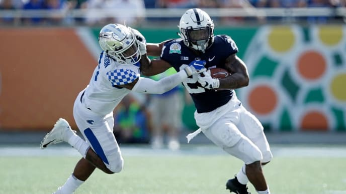 ORLANDO, FL - JANUARY 01: Miles Sanders #24 of the Penn State Nittany Lions runs the ball against the Kentucky Wildcats in the second quarter of the VRBO Citrus Bowl at Camping World Stadium on January 1, 2019 in Orlando, Florida. (Photo by Joe Robbins/Getty Images)