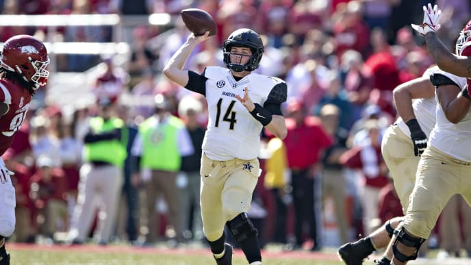 FAYETTEVILLE, AR - OCTOBER 27:  Kyle Shurmur #14 of the Vanderbilt Commodores throws a pass during a game against the Arkansas Razorbacks at Razorback Stadium on October 27, 2018 in Fayetteville, Arkansas. The Commodores defeated the Razorbacks 45-31.  (Photo by Wesley Hitt/Getty Images)