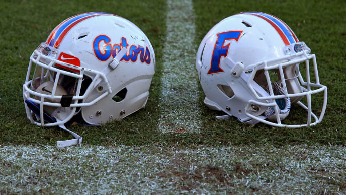 GAINESVILLE, FL - NOVEMBER 07: Florida Gators helmets sit on the field after the game against the Vanderbilt Commodores at Ben Hill Griffin Stadium on November 7, 2015 in Gainesville, Florida. (Photo by Rob Foldy/Getty Images)