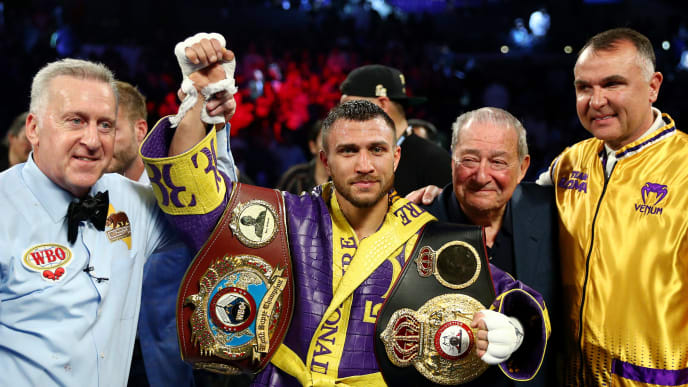 LOS ANGELES, CALIFORNIA - APRIL 12: Vasiliy Lomachenko celebrates defending his WBA/WBO lightweight titles after knocking out Anthony Crolla at Staples Center on April 12, 2019 in Los Angeles, California. (Photo by Yong Teck Lim/Getty Images)
