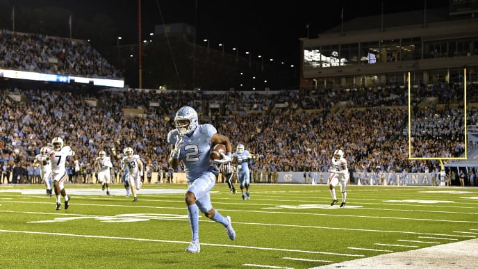 CHAPEL HILL, NORTH CAROLINA - NOVEMBER 02: Dyami Brown #2 of the North Carolina Tar Heels breaks away from the Virginia Cavaliers defense for a touchdown during the second quarter of their game at Kenan Stadium on November 02, 2019 in Chapel Hill, North Carolina. (Photo by Grant Halverson/Getty Images)