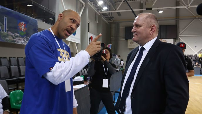 PRIENAI, LITHUANIA - JANUARY 09:  LaVar Ball father of LiAngelo and LaMelo Ball talks with Virginijus Seskus head coach of Vytautas Prienai during the match between Vytautas Prienai and Zalgiris Kauno on January 9, 2018 in Prienai, Lithuania.  (Photo by Alius Koroliovas/Getty Images)