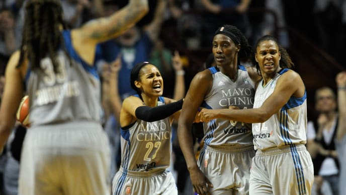 MINNEAPOLIS, MN - OCTOBER 04: (L-R) Seimone Augustus #33, Maya Moore #23, Sylvia Fowles #34 and Rebekkah Brunson #32 of the Minnesota Lynx celebrate a foul Fowles by the Los Angeles Sparks during the fourth quarter of Game Five of the WNBA Finals on October 4, 2017 at Williams in Minneapolis, Minnesota. NOTE TO USER: User expressly acknowledges and agrees that, by downloading and or using this Photograph, user is consenting to the terms and conditions of the Getty Images License Agreement. (Photo by Hannah Foslien/Getty Images)