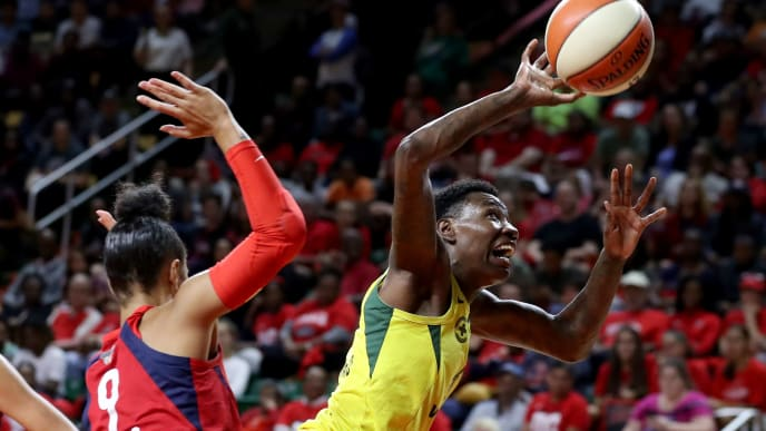FAIRFAX, VA - SEPTEMBER 12: Natasha Howard #6 of the Seattle Storm is fouled by Natasha Cloud #9 of the Washington Mystics in the first half during game three of the WNBA Finals at EagleBank Arena on September 12, 2018 in Fairfax, Virginia. (Photo by Rob Carr/Getty Images)