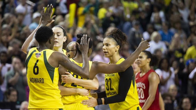 SEATTLE, WA - SEPTEMBER 09:  Natasha Howard #6 of the Seattle Storm high-fives Breanna Stewart #30 as Sue Bird #10 hugs Jewell Loyd #24, who reaches out to hug Alysha Clark #32 as the Storm lead the Washington Mystics with 1.8 seconds left during the second half of Game 2 of the WNBA Finals at KeyArena on September 9, 2018 in Seattle, Washington. The Seattle Storm beat the Washington Mystics 75-73. (Photo by Lindsey Wasson/Getty Images)