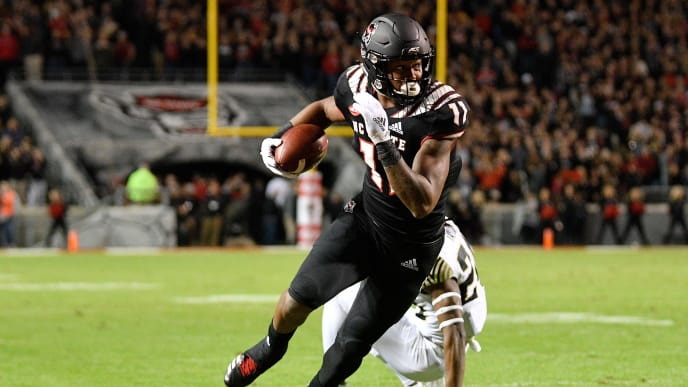 RALEIGH, NORTH CAROLINA - NOVEMBER 08: Jakobi Meyers #11 of the North Carolina State Wolfpack makes a catch against Ja'Sir Taylor #24 of the Wake Forest Demon Deacons during the first half of their game at Carter-Finley Stadium on November 08, 2018 in Raleigh, North Carolina. (Photo by Grant Halverson/Getty Images)