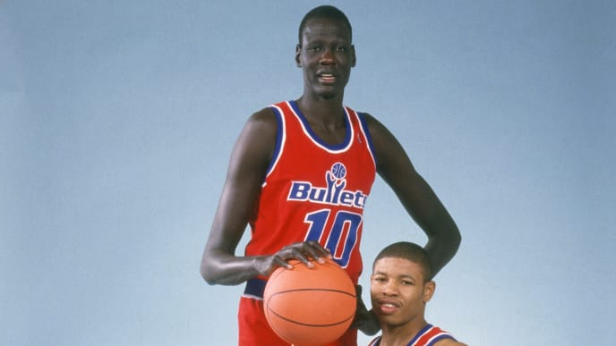 LANDOVER, MD - CIRCA 1987:  Manute Bol #10 and Muggsy Bogues #1 of the Washington Bullets poses together for this portrait circa 1987 at the Capital Centre in Landover, Maryland. Bol played for the Bullets from 1985-88. (Photo by Focus on Sport/Getty Images)