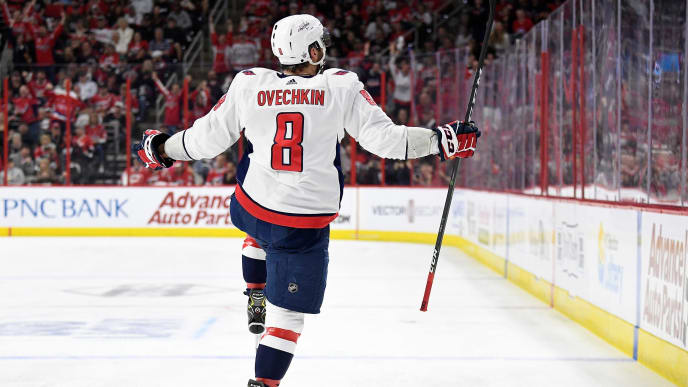 RALEIGH, NORTH CAROLINA - APRIL 18: Alex Ovechkin #8 of the Washington Capitals celebrates after scoring a goal against the Carolina Hurricanes in the second period in Game Four of the Eastern Conference First Round during the 2019 NHL Stanley Cup Playoffs at PNC Arena on April 18, 2019 in Raleigh, North Carolina. (Photo by Grant Halverson/Getty Images)