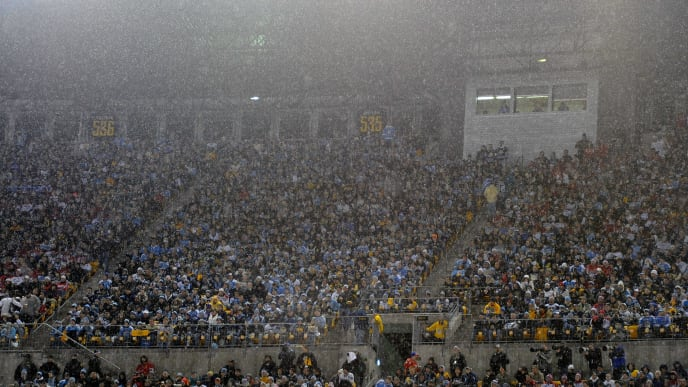 PITTSBURGH, PA - JANUARY 01:  Fans sit in the rain as they watch the Pittsburgh Penguins take on the Washington Capitals during the 2011 NHL Bridgestone Winter Classic at Heinz Field on January 1, 2011 in Pittsburgh, Pennsylvania.  (Photo by Jamie Sabau/Getty Images)