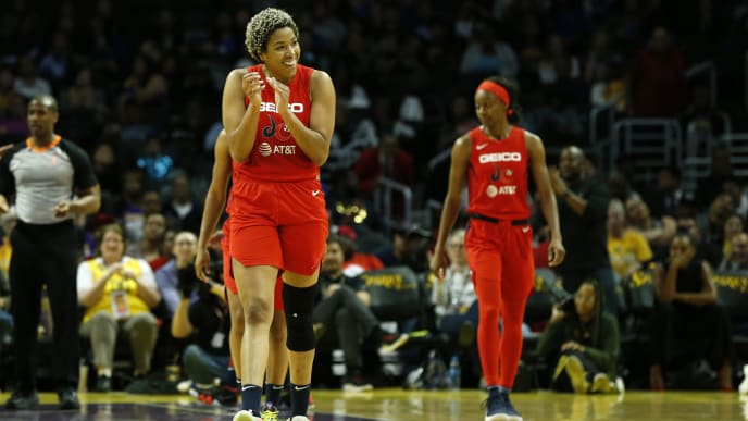 LOS ANGELES, CALIFORNIA - JUNE 18:  Forward Tianna Hawkins #21 of the Washington Mystics claps after she was fouled during a game against the Los Angeles Sparks  at Staples Center on June 18, 2019 in Los Angeles, California. NOTE TO USER: User expressly acknowledges and agrees that, by downloading and or using this photograph, User is consenting to the terms and conditions of the Getty Images License Agreement. (Photo by Katharine Lotze/Getty Images)