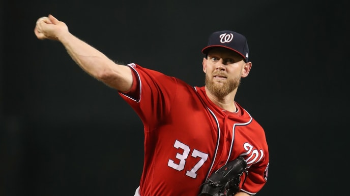 PHOENIX, ARIZONA - AUGUST 03:  Starting pitcher Stephen Strasburg #37 of the Washington Nationals throws a warm-up pitch during the first inning of the MLB game against the Arizona Diamondbacks at Chase Field on August 03, 2019 in Phoenix, Arizona. The Diamondbacks defeated the Nationals 18-7. (Photo by Christian Petersen/Getty Images)