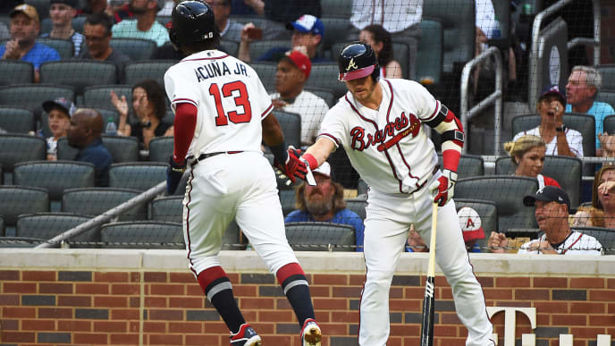 ATLANTA, GEORGIA - JULY 20: Ronald Acuna Jr. #13 of the Atlanta Braves scores a run against the Washington Nationals in the first inning  at SunTrust Park on July 20, 2019 in Atlanta, Georgia. (Photo by Logan Riely/Getty Images)