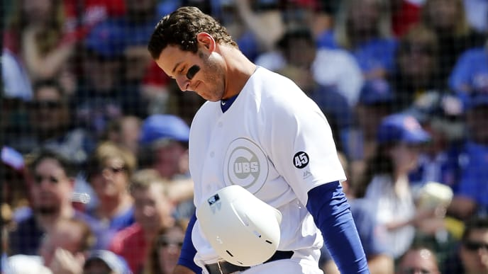 CHICAGO, ILLINOIS - AUGUST 23: Anthony Rizzo #44 of the Chicago Cubs throws his helmet after striking out during the fourth inning of a game against the Washington Nationals at Wrigley Field on August 23, 2019 in Chicago, Illinois. Teams are wearing special color schemed uniforms with players choosing nicknames to display for Players' Weekend. (Photo by Nuccio DiNuzzo/Getty Images)