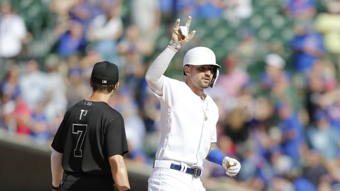 CHICAGO, ILLINOIS - AUGUST 23: Nicholas Castellanos #6 of the Chicago Cubs gestures following his RBI double during the ninth inning of a game against the Washington Nationals at Wrigley Field on August 23, 2019 in Chicago, Illinois. Teams are wearing special color schemed uniforms with players choosing nicknames to display for Players' Weekend. (Photo by Nuccio DiNuzzo/Getty Images)