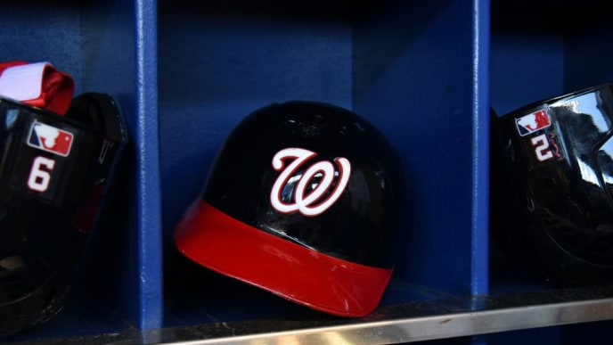 MIAMI, FL - APRIL 21: A detailed view of a Washington Nationals batting helmet in the dugout before the start of the game against the Miami Marlins at Marlins Park on April 21, 2019 in Miami, Florida. (Photo by Eric Espada/Getty Images)