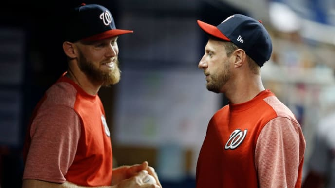MIAMI, FLORIDA - APRIL 19: Max Scherzer #31 of the Washington Nationals talks with Stephen Strasburg #37 in the dugout against the Miami Marlins at Marlins Park on April 19, 2019 in Miami, Florida. (Photo by Michael Reaves/Getty Images)