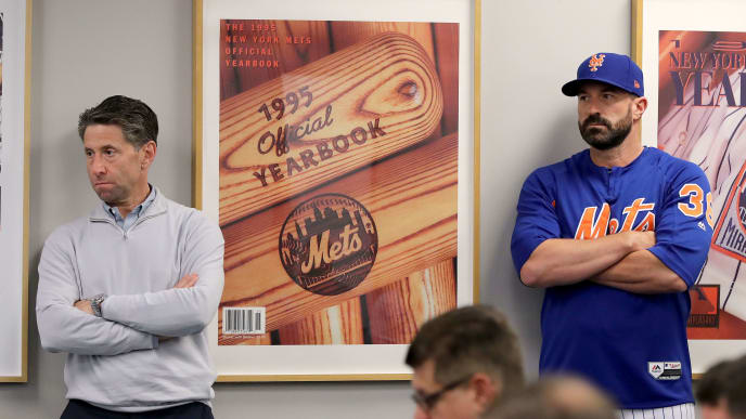 NEW YORK, NEW YORK - MAY 20:  New York Mets chief operating officer Jeff Wilpon and manager Mickey Callaway #36 of the New York Mets listen to Mets general manager Brodie Van Wagenen speak during a press conference at Citi Field on May 20, 2019 in the Flushing neighborhood of the Queens borough of New York City. (Photo by Elsa/Getty Images)
