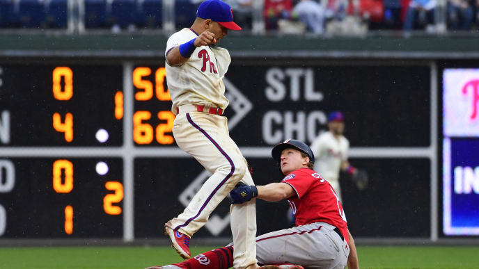 PHILADELPHIA, PA - MAY 05: Cesar Hernandez #16 of the Philadelphia Phillies turns to throw to first base as Andrew Stevenson #17 of the Washington Nationals slides into him during the seventh inning at Citizens Bank Park on May 5, 2019 in Philadelphia, Pennsylvania. The Phillies defeated the Nationals 7-1. (Photo by Corey Perrine/Getty Images)