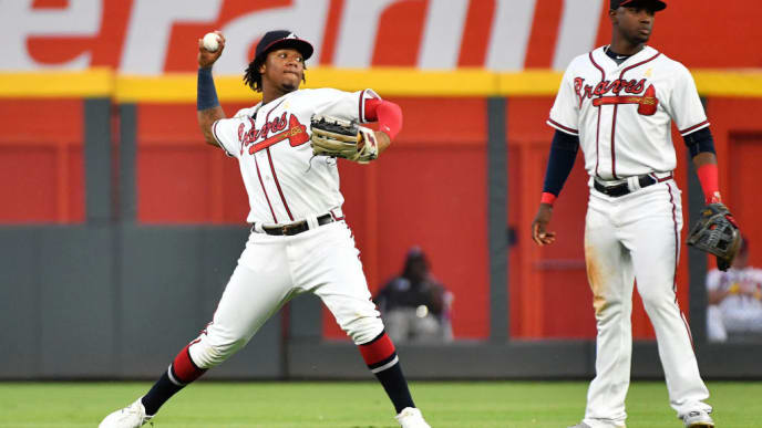 ATLANTA, GEORGIA - SEPTEMBER 07: Ronald Acuna Jr. #13 of the Atlanta Braves fields a ball in the second inning against the Washington Nationals  at SunTrust Park on September 07, 2019 in Atlanta, Georgia. (Photo by Logan Riely/Getty Images)