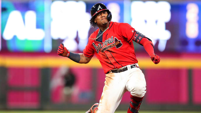 ATLANTA, GA - JULY 19: Ronald Acuna Jr. #13 of the Atlanta Braves celebrates at second base after hitting a double to center field scoring Austin Riley #27 in the sixth inning during the game against the Washington Nationals at SunTrust Park on July 19, 2019 in Atlanta, Georgia. (Photo by Carmen Mandato/Getty Images)