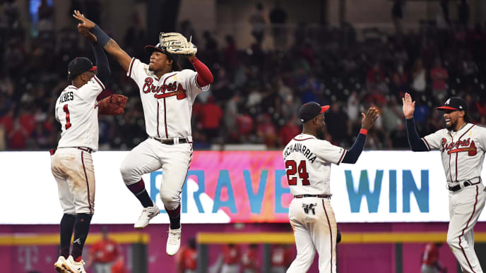 ATLANTA, GEORGIA - SEPTEMBER 07: Ozzie Albies #1 and Ronald Acuna Jr. #13 of the Atlanta Braves high five along with teammates Adeiny Hechavarria #24 and Billy Hamilton #9 after defeating the Washington Nationals at SunTrust Park on September 07, 2019 in Atlanta, Georgia. (Photo by Logan Riely/Getty Images)