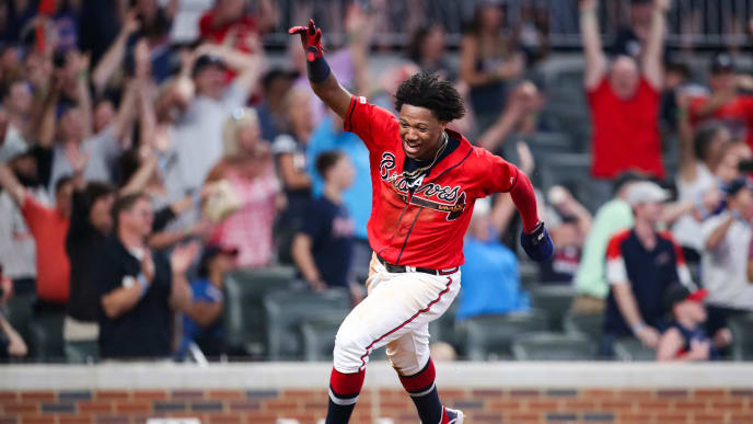 ATLANTA, GA - JULY 19: Ronald Acuna Jr. #13 scores on a single from Josh Donaldson #20 of the Atlanta Braves in the ninth inning during the game against the Washington Nationals at SunTrust Park on July 19, 2019 in Atlanta, Georgia. (Photo by Carmen Mandato/Getty Images)