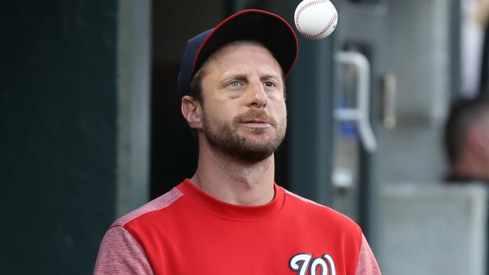 DETROIT, MI - JUNE 27: Max Scherzer #31 of the Washington Nationals tosses a ball in the dugout during the fifth inning of the game against the Detroit Tigers at Comerica Park on June 28, 2019 in Detroit, Michigan. (Photo by Leon Halip/Getty Images)