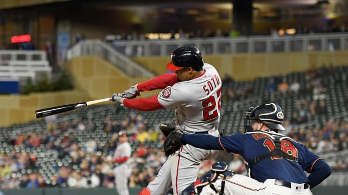 MINNEAPOLIS, MINNESOTA - SEPTEMBER 12: Juan Soto #22 of the Washington Nationals hits a two-run home run against the Minnesota Twins during the sixth inning of the interleague game at Target Field on September 12, 2019 in Minneapolis, Minnesota. The Nationals defeated the Twins 12-6. (Photo by Hannah Foslien/Getty Images)