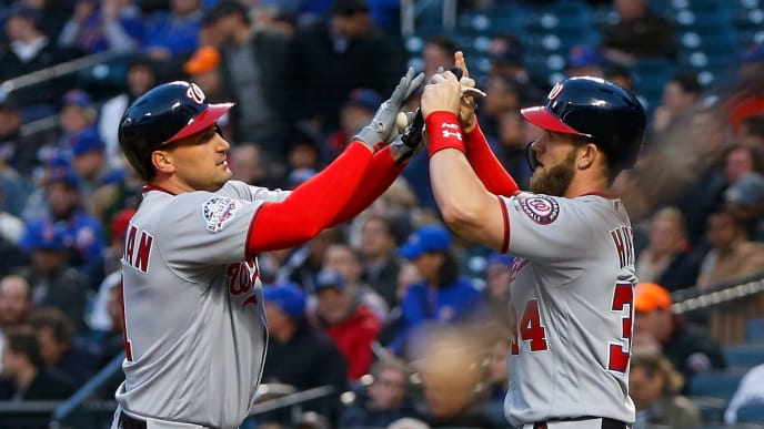 NEW YORK, NY - APRIL 18:  Ryan Zimmerman #11 of the Washington Nationals celebrates his first-inning, three-run home run against the New York Mets with teammate Bryce Harper #34 at Citi Field on April 18, 2018 in the Flushing neighborhood of the Queens borough of New York City.  (Photo by Jim McIsaac/Getty Images)