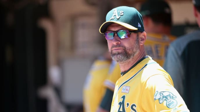 OAKLAND, AZ - JUNE 03:  Bench coach Mark Kotsay #7 of the Oakland Athletics in the dugout before the MLB game against the Washington Nationals at Oakland Coliseum on June 3, 2017 in Oakland, California.  (Photo by Christian Petersen/Getty Images)