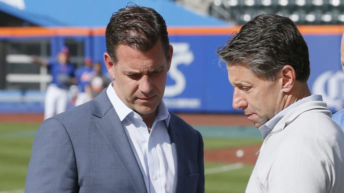 NEW YORK, NY - MAY 20:  General Manager Brodie Van Wagenen and Chief Operating Officer Jeff Wilpon of the New York Mets, talk on the field during batting practice moments after Van Wagenen held a press conference before an MLB baseball game against the Washington Nationals on May 20, 2019 at Citi Field in the Queens borough of New York City. Mets won 5-3. (Photo by Paul Bereswill/Getty Images)