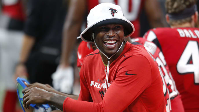 ATLANTA, GA - AUGUST 22: Wide receiver Julio Jones #11 of the Atlanta Falcons has some laughs on the sidelines in the second half of an NFL preseason game against the Washington Redskins at Mercedes-Benz Stadium on August 22, 2019 in Atlanta, Georgia. (Photo by Todd Kirkland/Getty Images)