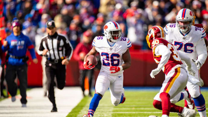 ORCHARD PARK, NY - NOVEMBER 03:  Devin Singletary #26 of the Buffalo Bills carries the ball during the first quarter against the Washington Redskins at New Era Field on November 3, 2019 in Orchard Park, New York. Buffalo defeats Washington 24-9.  (Photo by Brett Carlsen/Getty Images)
