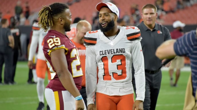 CLEVELAND, OHIO - AUGUST 08: Running back Derrius Guice #29 of the Washington Redskins talks with wide receiver Odell Beckham #13 of the Cleveland Browns after a preseason game at FirstEnergy Stadium on August 08, 2019 in Cleveland, Ohio. The Browns defeated the Redskins 30-10. (Photo by Jason Miller/Getty Images)